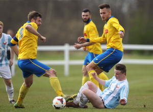Adam Nicholson (right) in Shipowners Cup Final action, scored Stockton Town's 500th goal in senior football with the teams second goal against Ashbrooke Belford House.