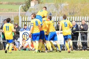 Players mob Max Craggs after his goal against Cleator Moor.