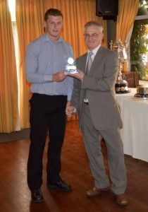 Kallum receiving his award from Tom Radican of Durham FA.