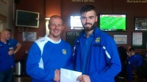 Tom Coulthard receiving his September Player of the Month Award from 1st Team Manager Michael Dunwell.