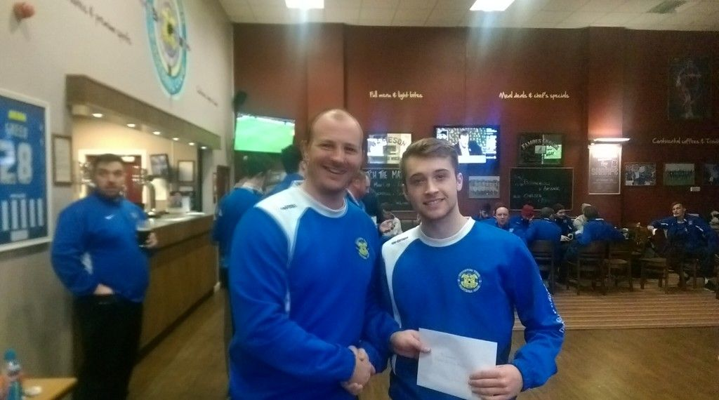 1st Team Manager Michael Dunwell handing over the December Player of the Month Award.