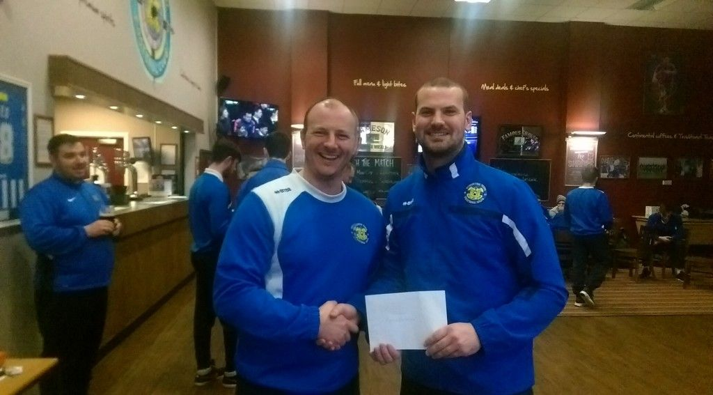Chris receiving his Player of the Month Award from Manager Michael Dunwell.