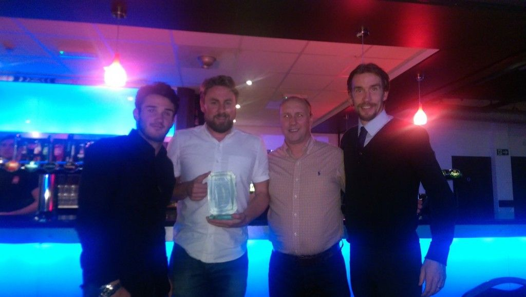 Chris Stockton, JD Briggs, Jamie Farley and Alan Cossavella receive the Award on behalf of the Club.