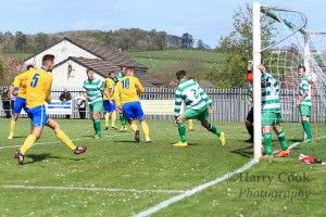 Stockton's No.10 Kallum Hannah turns in the 1st goal of the Cup Final.