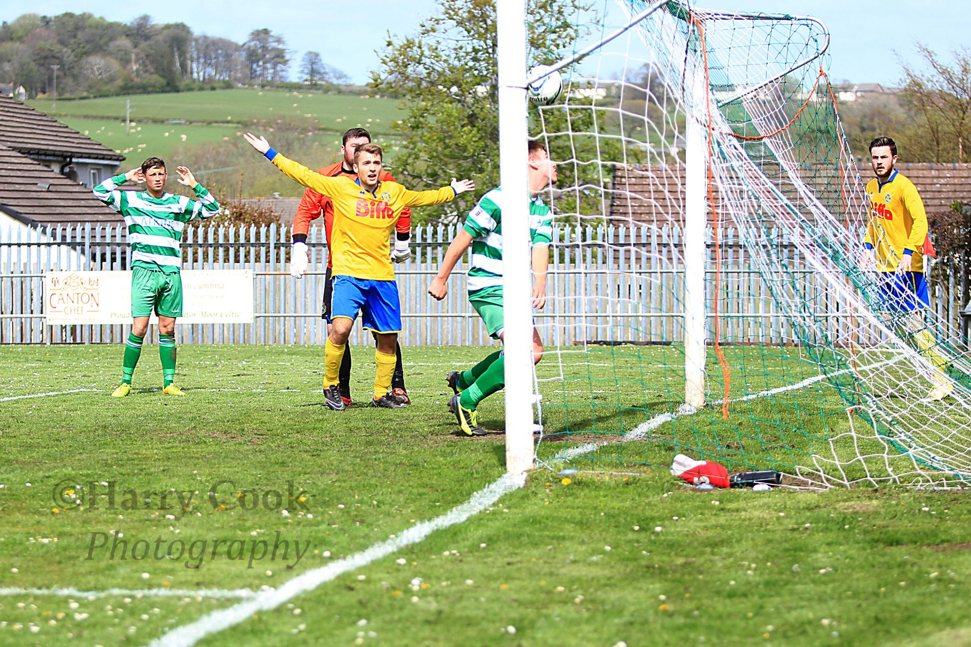 Cleatermoor defender clears of the line