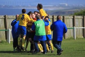 Michael Arthur Goalkeeper of Stockton Town FC is mobbed by his team mates after the penalty shoot out as Stockton went on to win the League Cup and claim the quadruple.