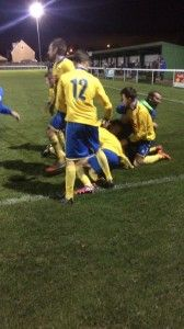 The team celebrate Matty Garbutts stoppage time winner.