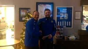 """Captain Stav Roberts collecting his """"Peking Garden Player of the Month Award"""" from 1st Team Manager Michael Dunwell."""