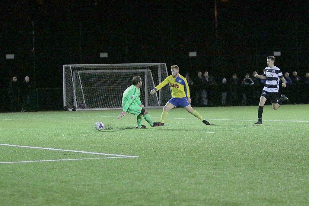 Kallum Hannah slips the ball past the Darlington goalkeeper to open the scoring.