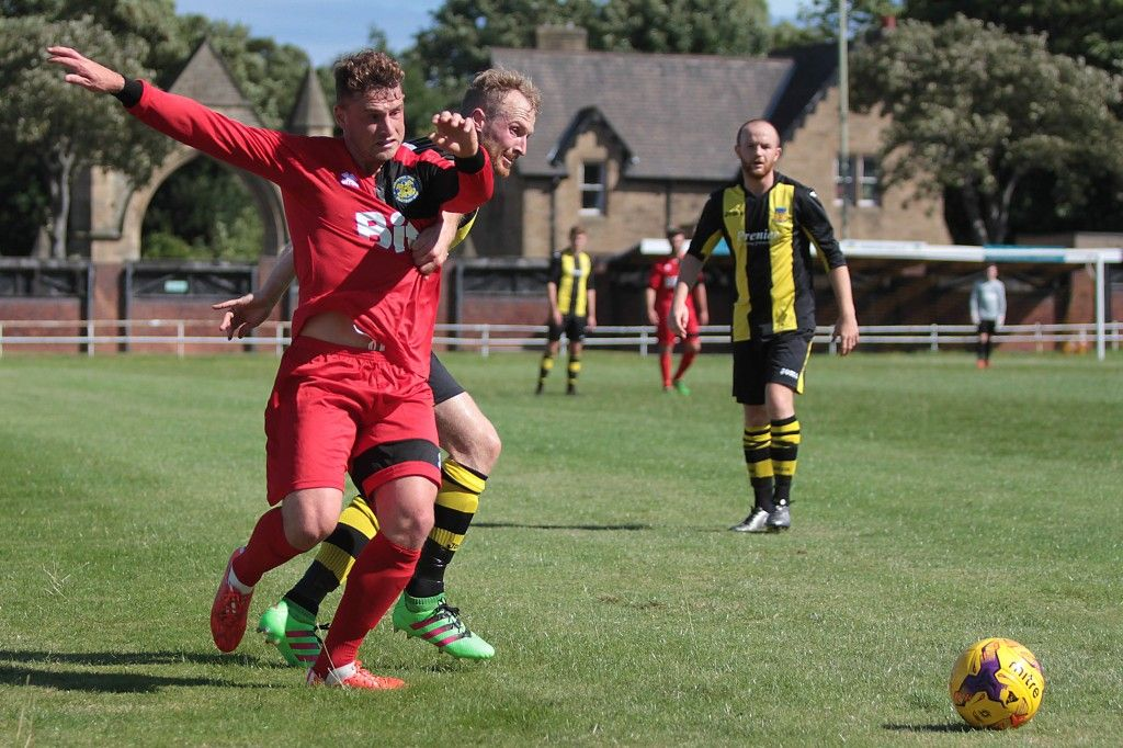 Fred Woodhouse challenges for the ball during yesterdays two goal victory.