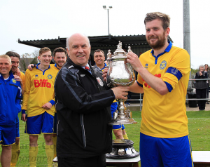 Club Captain Stav Roberts being presented with the Monkwearmouth Charity Cup from League Chairman Mr Peter Maguire after last seasons victory at Cleator Moor Celtic